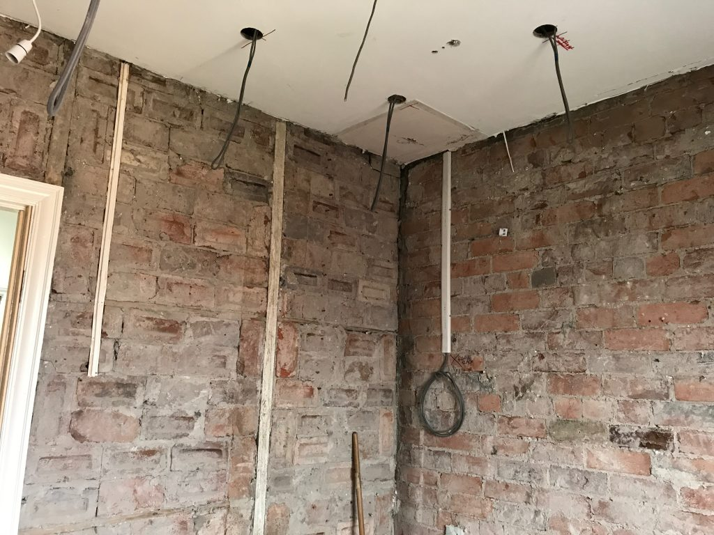 commercial refurbishment in progress showing blockwork and first fix electrical installation